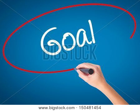 Women Hand Writing Goal  With Black Marker On Visual Screen