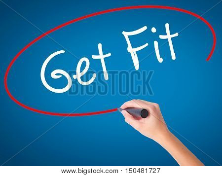 Women Hand Writing Get Fit  With Black Marker On Visual Screen