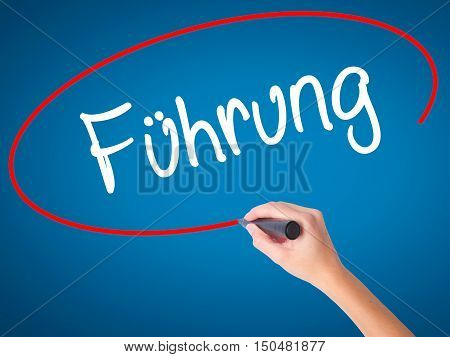 Women Hand Writing Fuhrung (leadership In German) With Black Marker On Visual Screen.