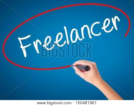 Women Hand Writing Freelancer With Black Marker On Visual Screen.