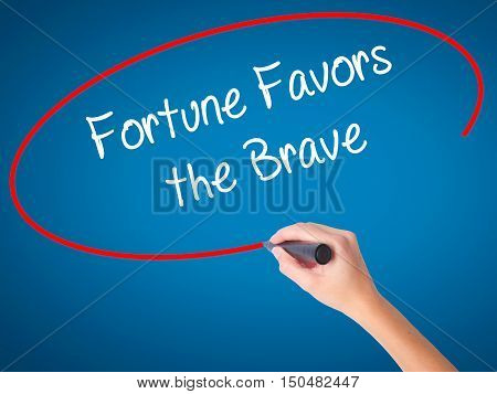 Women Hand Writing Fortune Favors The Brave With Black Marker On Visual Screen