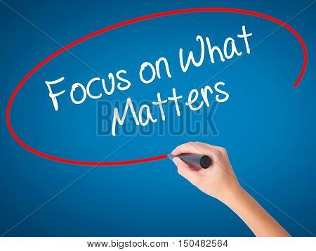 Women Hand Writing Focus On What Matters With Black Marker On Visual Screen