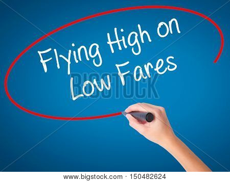 Women Hand Writing Flying High On Low Fares With Black Marker On Visual Screen