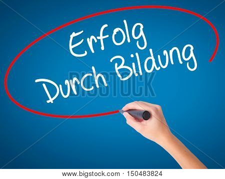 Women Hand Writing Erfolg Durch Bildung  (success Through Training In German) With Black Marker On V
