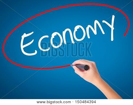 Women Hand Writing Economy With Black Marker On Visual Screen.
