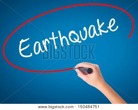 Women Hand Writing Earthquake With Black Marker On Visual Screen