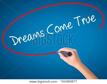Women Hand Writing Dreams Come True With Black Marker On Visual Screen