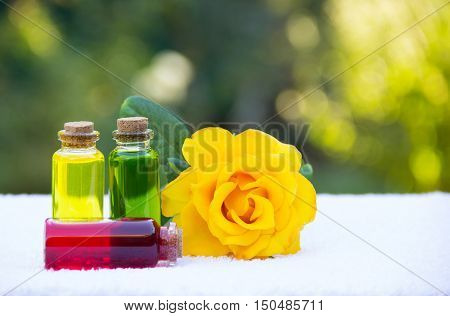 Vials with floral elixir. Spa concept. Fragrant yellow rose.