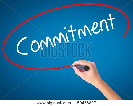Women Hand Writing Commitment With Black Marker On Visual Screen.