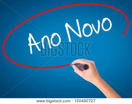 """Women Hand Writing """"ano Novo"""" (in Portuguese: New Year) With Black Marker On Visual Screen"""