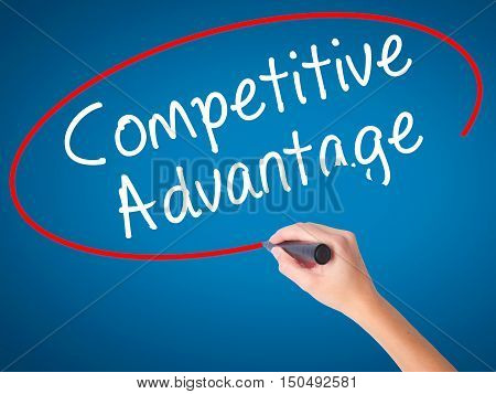 Women Hand Writing Competitive Advantage With Black Marker On Visual Screen