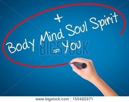 Women Hand Writing Body + Mind + Soul + Spirit = You With Black Marker On Visual Screen