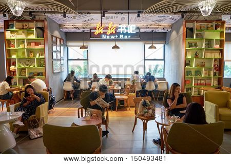 SHENZHEN, CHINA - SEPTEMBER 09, 2016: interior of a cafe at a book store in Shenzhen. Shenzhen is a major city in Guangdong Province, China.