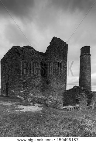 A derelict building and a chimney at a disused mine Magpie Mine in the Peak District