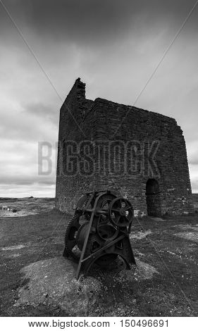 A derelict building and disused machinery at Magpie Mine in the Peak District