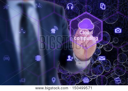 IT expert touches a cloud symbol in a hexagon grid with IOT icons on a digital letter glass spheres network background