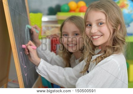 Portrait of a cute girls on lesson of art