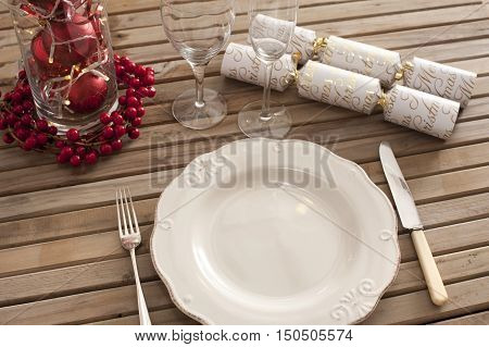 Overhead view of place setting with classic plate and christmas accents
