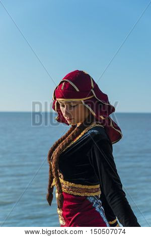 young woman dancing georgian national clothes sea outdoors summer sunny