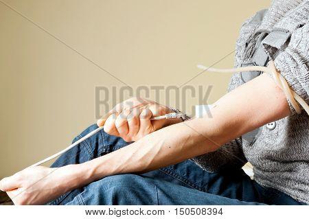 Internet addiction creative concept: junkie gives himself a vine using internel lan cabel