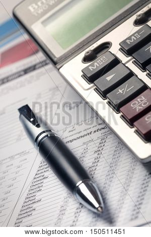 Pen And Calculator On Financial Reports Close-up