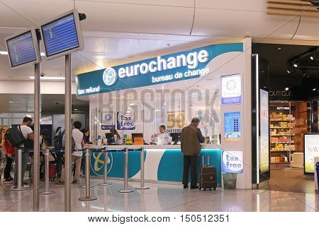 ATHENS GREECE - May 05: Currency exchange and tax refund counter at Athens International with people waiting in line in Athens Greece - May 05 2015; People waiting in line at the airport to exchange currency and submit papers for tax refund of the goods t