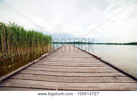 wooden pier over lake at sunny day