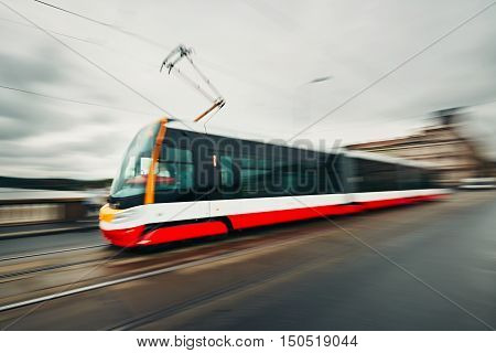 Daily life in the city. Tram of the public transport on the street - blurred motion