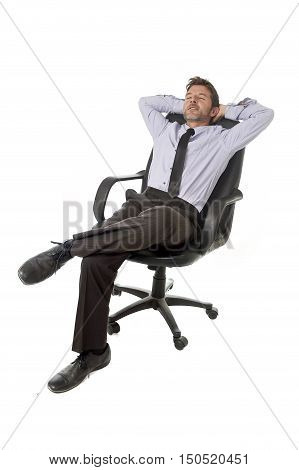 young happy attractive businessman leaning relaxed sitting on office chair isolated on white background in success and relax at work concept and successful satisfied business man