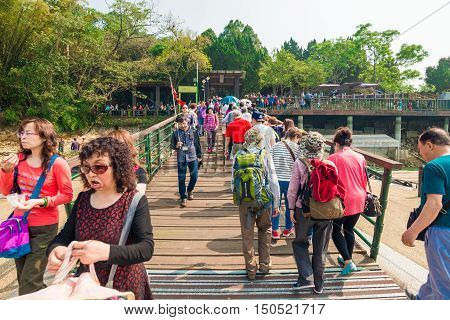 SUN MOON LAKE - MARCH 20: Tourist with boats parking at the pier on March 20 2015 at Sun Moon Lake Taiwan. Sun Moon Lake is the largest body of water in Taiwan as well as a tourist attraction.