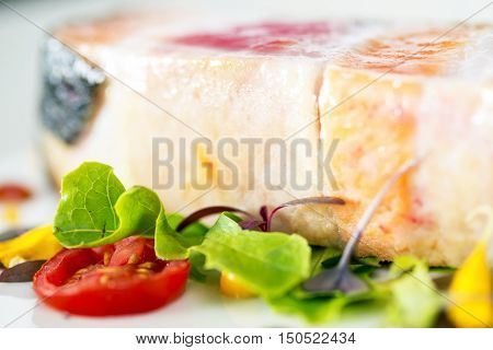 close-up grilled salmon steak slices in dish