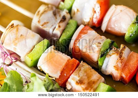 Close-up Skewers Fish Steak On Dish With Vegetables