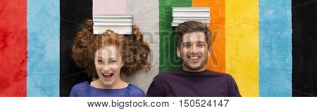 Smiling students before session with books on head