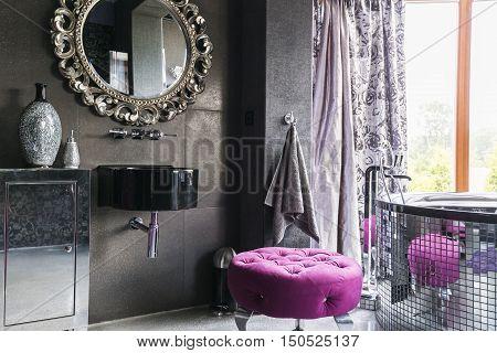 Unusual Bathroom With Round Mirrow