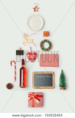 Christmas dinner objects organized as christmas tree for mock up template design. View from above. Flat lay