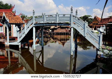 Samut Prakan Thailand - January 15 2013: Wooden bridge spans the lagoon in the Floating Market Village at Ancient Siam heritage park *