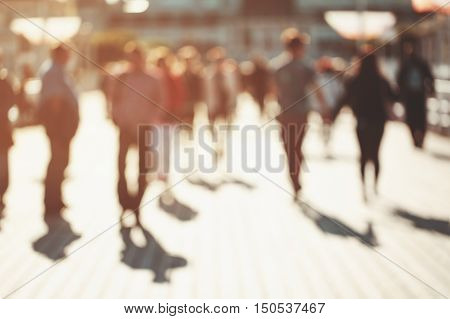 Blurred background of unrecognizable persons walking along the pier in Sopot, Poland. Vintage toning. poster