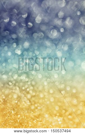 Winter snow background with magic bokeh effect, glitter abstract festive background.