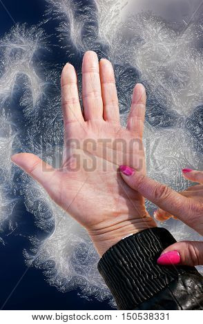 Index finger point to mind a line on the left female hand on an abstract blue background