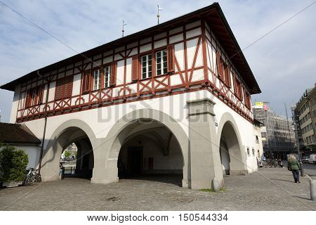LUCERNE SWITZERLAND - MAY 02 2016: The view from outside the building under which the passage leads to the Spreuer Bridge (Spreuerbrücke) that is located on the left bank of the river Reuss.