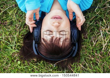 girl listening to music on headphones. The concept of lifestyle.