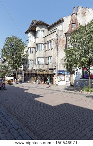 ZAKOPANE POLAND - SEPTEMBER 12 2016: The brick house named Dom Krzyzaka was built in 1936 at the Krupowki street in the downtown. Nowadays on the ground floor there is a souvenir shop