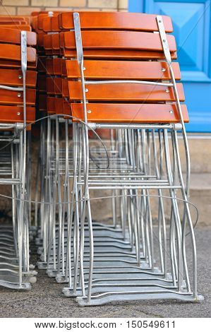 Folding chairs of a cafeteria on a sidewalk