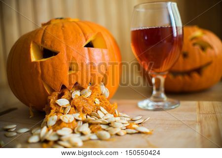 Pumpkin Puking With Pumpkin Seeds On Wood Table, Glass Of Wine