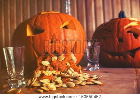 Pumpkin Puking With Pumpkin Seeds On Wood Table, Vodka, Vintage Effect