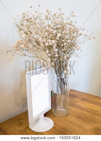 Dry brown flowers decorated on wooden table.