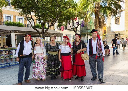 ALGECIRAS, SPAIN - SEPTEMBER 24: Group of senior people in traditional Andalusian clothing during folk festival at the Plaza Alta in Algeciras, Spain on September 24, 2016.