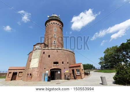 KOLOBRZEG POLAND - JUNE 22 2016: Massive building of the lighthouse. This is one of the most recognizable and most visited tourist attractions in the city.