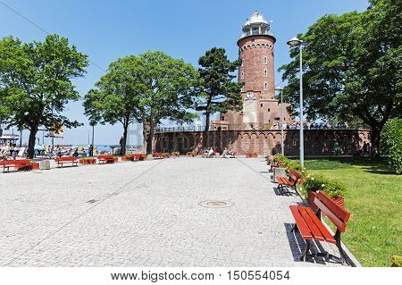 KOLOBRZEG POLAND - JUNE 22 2016: The lighthouse with height of 26 meters is one of the most recognizable tourist attractions in the city and it can be seen from afar