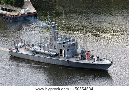 KOLOBRZEG POLAND - JUNE 22 2016: Torpedo boat on the waterway from port. The boat was decommissioned in 2001 and was later adapted for the sightseeing cruises it is shown how departs from port.